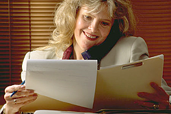 Woman Reviewing Folder